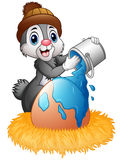 Easter bunny sprinkle of paint on eggs in the nest. Illustration of Easter bunny sprinkle of paint on eggs in the nest Stock Image