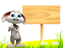 Easter bunny stands near wooden sign Stock Photography