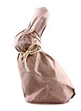 Easter bunny surprise wrapped in brown paper Royalty Free Stock Photography