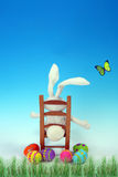 Easter Bunny Taking A Rest. From Painting and Hiding Easter Eggs royalty free stock photos