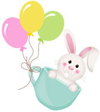 Easter bunny in teacup with balloons Royalty Free Stock Photography