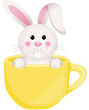 Easter bunny in teacup. Scalable vectorial image representing a Easter bunny in teacup, on white royalty free illustration