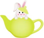 Easter bunny in teapot Stock Photos