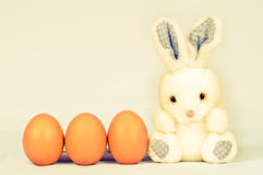 Easter bunny with three eggs Stock Photography