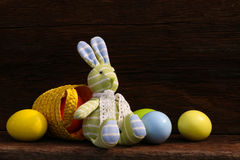 Easter Bunny Toy and Eggs on Rough Background Royalty Free Stock Photography