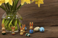 Easter Bunny under daffodils Stock Images