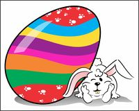 This Easter Bunny is waiting for you. A Bunny with its huge and colorful Easter egg, on neutral white background Royalty Free Stock Photos