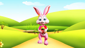 Easter Bunny walking with eggs Royalty Free Stock Photography