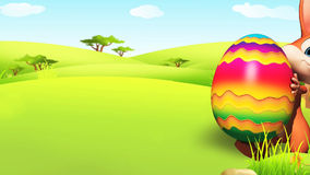 Easter Bunny walking with eggs Royalty Free Stock Image
