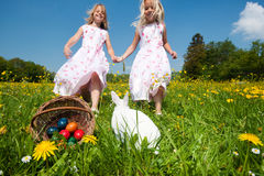 Easter bunny watching the egg hunt royalty free stock photography