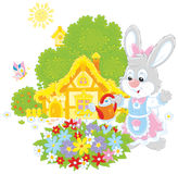 Easter Bunny watering flowers Stock Photos
