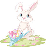 Easter Bunny with wheelbarrow. Full of eggs Stock Photography