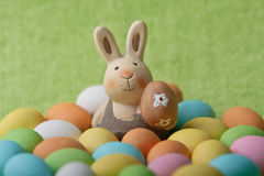 Easter bunny whit many colored easter eggs Royalty Free Stock Photos