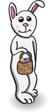 Easter bunny. White bunny holding basket with colored eggs for easter Royalty Free Stock Photos