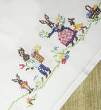 Easter bunny on a white tablecloth. Easter bunny on a white tablecloth embroidered with a cross, Easter theme Royalty Free Stock Photography
