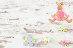 Easter bunny on wooden background Royalty Free Stock Photos