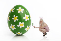 Easter bunny at work. Female easter bunny at work in front of a white background Royalty Free Stock Images