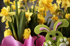 Easter bunny and yellow daffodils. Stock Photos