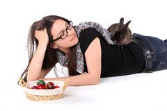 Easter bunny with young girl and Easter eggs Stock Image