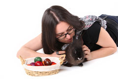 Easter bunny with young girl and Easter eggs Stock Photography