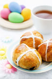 Easter buns with a cross and eggs Royalty Free Stock Photography