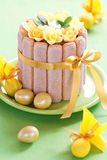 Easter cake. Easter chocolate cake decorated with flowers and quail eggs, selective focus Stock Photo