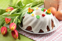 Easter cake. Eggs and bunch of tulips royalty free stock photo
