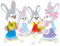 Easter cake. Family of rabbits celebrating Easter with a holiday cake Stock Photos