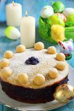 Easter cake and basket with colorful eggs. Royalty Free Stock Photography