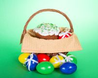 Easter cake in a basket and colourful eggs Stock Images