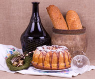 Easter cake and bottle with quail eggs Royalty Free Stock Photos