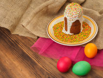 Easter cake, ceramic bowl with colorful sweet powder and easter colored egg. Russian and Ukrainian, orthodox slavic Royalty Free Stock Photography
