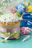 Easter cake, colored eggs and presents in blue boxes Stock Photography