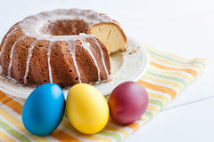 Easter cake and colored eggs Royalty Free Stock Image