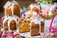 Easter cake and colorful chocolate candy eggs Stock Photos