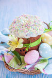Easter cake and colorful eggs on table Stock Image