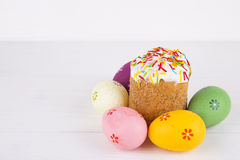 Easter cake with colorful eggs on white wooden background Royalty Free Stock Photo