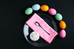 The Easter cake and colourful  eggs on a black table Royalty Free Stock Images