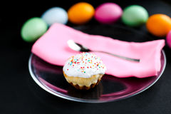 The Easter cake and colourful eggs on a black table Royalty Free Stock Photo
