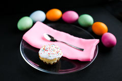 The Easter cake and colourful eggs on a black table Stock Photography