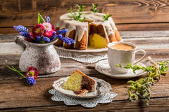 Easter cake, cup of coffee and spring flowers Stock Photo