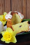 Easter cake and daffodils Stock Images