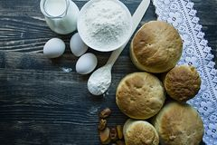 Easter cake on a dark background. Fresh cakes with dried fruits. The process of making Easter cakes. View from above.  stock image