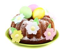 Easter cake decorated with flowers. Easter cake decorated with flowers on a white background royalty free stock images