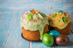 Easter cake. Easter cake with Easter decorative eggs on a decorative wooden background in rustic style Royalty Free Stock Image