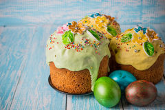 Easter cake. Easter cake with Easter decorative eggs on a decorative wooden background in rustic style Royalty Free Stock Images