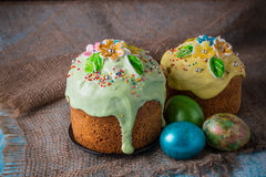 Easter cake. Easter cake with Easter decorative eggs on a decorative wooden background in rustic style Royalty Free Stock Photos