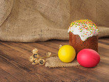 Easter cake and easter colored egg with dry flower. Russian and Ukrainian, orthodox, slavic traditional Easter kulich on Royalty Free Stock Photos