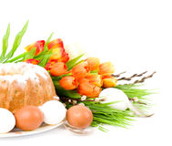 Easter cake and easter eggs with flowers stock photo