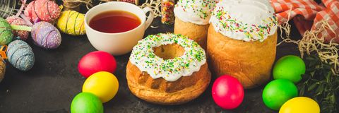 Easter cake and Easter eggs, traditional holiday attributes Happy Easter!. food background. top view stock photo